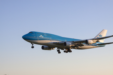 boeing 747: AMSTERDAM, THE NETHERLANDS - SEPTEMBER 30, 2015: Boeing 747 from klm airlines will land on the runway by the sun shining
