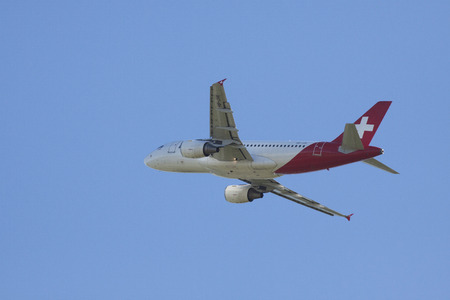 ascended: AMSTERDAM, THE NETHERLANDS - SEPTEMBER 30, 2015: Of the runway ascended Helvetic Airways Airbus A319 on the way to his destination on a sunny day