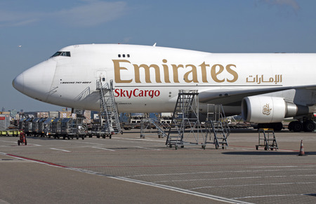 747 400: AMSTERDAM, THE NETHERLANDS - SEPTEMBER 30, 2015: Parked white Boeing 747-400 cargo plane from Dubai emirates airliner loaded with cargo