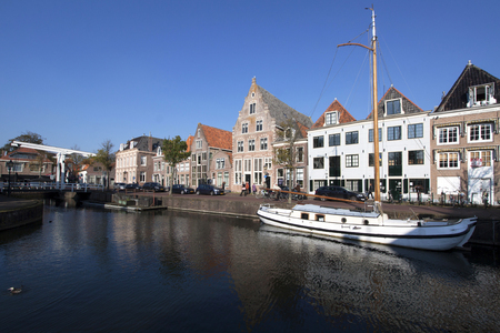 homeownership: Old historical dutch houses and boat in the habour Editorial