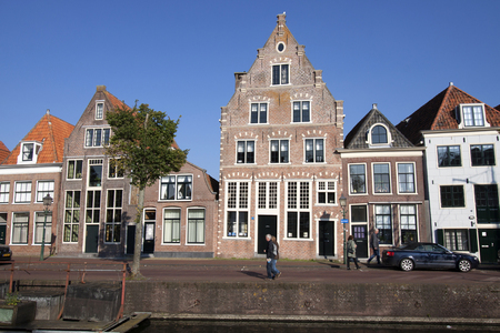 homeownership: Amsterdam, the Netherlands - October 10, 2015: Old house on the habour of the historic Dutch town of Hoorn. This city is popular by tourists