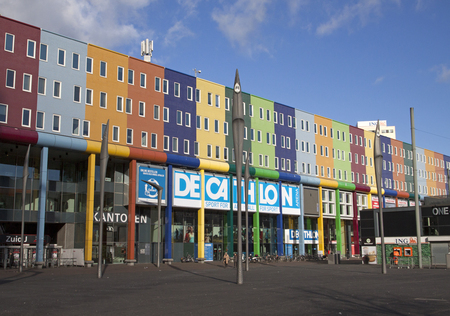 surmounted: AMSTERDAM, THE NETHERLANDS - FEBRUARY 15.2016: Decathlon sports store surmounted by a beautiful facade with different colors