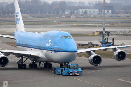 just arrived: AMSTERDAM, THE NETHERLANDS - March 15, 2015: Boeing 747 just arrived on our way to the gate at the airport of Schiphol