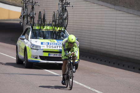 bystanders: UTRECHT, NETHERLANDS JUL 4: The Italian cyclist Tossato or Tinkoff-Saxo team riding during the first stage (individual time trial) or Le Tour de France 2015