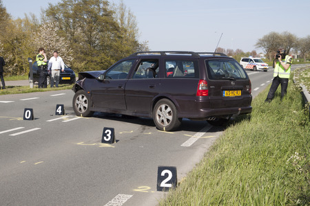 involving: Bovenkarspel, the Netherlands - May 5, 2016: The traffic police do a thorough investigation Following an Accident Involving several at cars, s were bettrokken. and the road for a few hours was Deposited for safety.