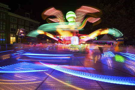 Photo of a fairground ride taken with a long exposure, Which gives beautifuleffects