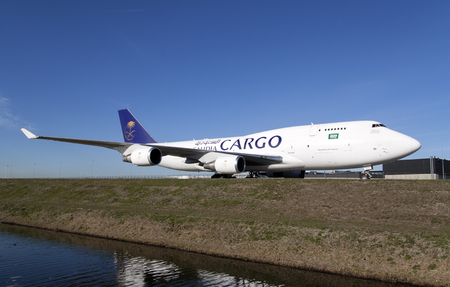 AMSTERDAM, THE NETHERLANDS - March 11, 2015: .Large white Boeing 747 saudia cargo freighter that has just landed with a beautiful blue sky