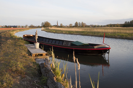 Picturesquely view of a rural scene of a ditch with an old steel heavy boat