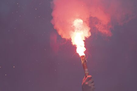 Hot fire torch with smoke from a football supporter