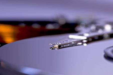 Exposed laptop hard disk drive head Stock Photo