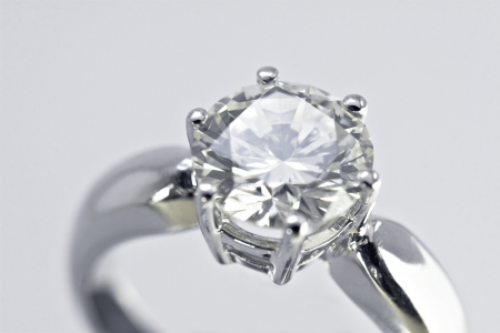 diamond stones: Two carat diamond engagement ring with white background