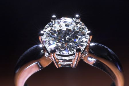 Two carat diamond engagement ring with dark background