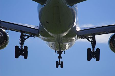Plane landing with close-up of gears down Stock Photo