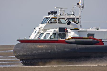Coast guard hovercraft on a beach