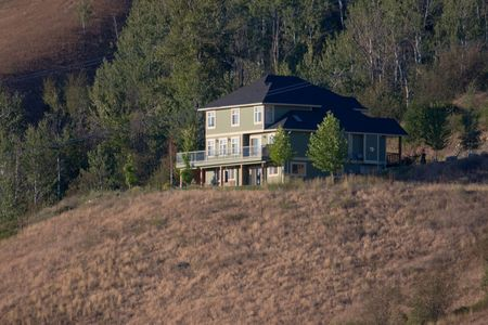 Large house on a hill in the Okanagan valley in Vernon British Columbia