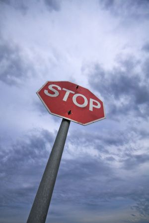 Stop sign with a cloudy sky background Stock Photo