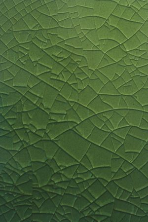 Cracked green glass lined background