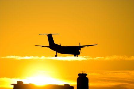 Airplane landing during the sunset