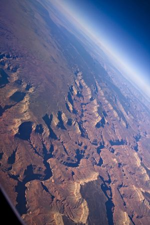 Sunrise aerial shot of the Grand Canyon ( North & South rim) and the curviture of the earth