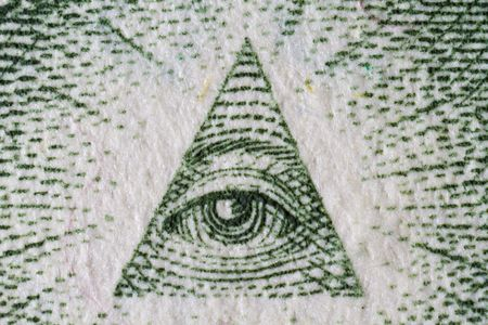 Extreme closeup of the great seal on the one dollar bill
