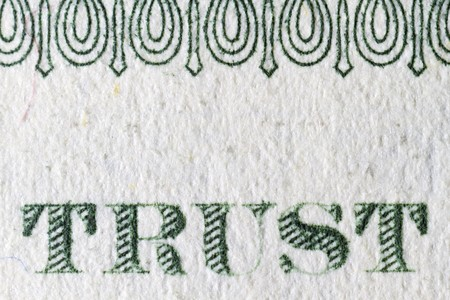 Extreme closeup of the one dollar note Trust