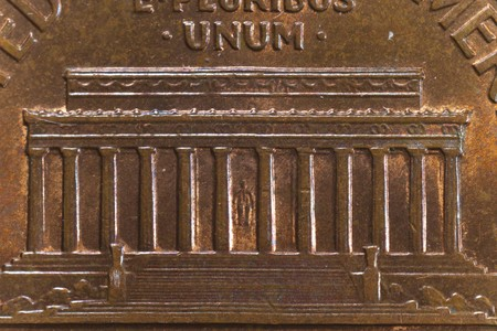Extreme closeup of the Lincoln Memorial on the one cent coin