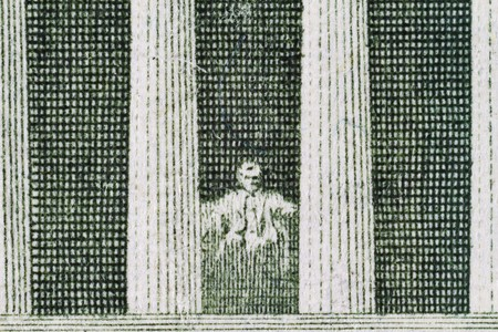 Extreme closeup of the Lincoln Memorial on the five dollar note Stock Photo