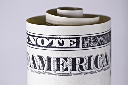 Closeup of a rolled US one dollar note showing the word america