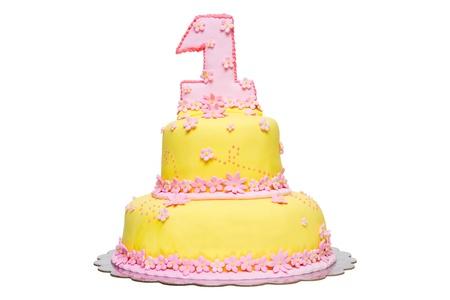 Happy First Birthday Yellow Fondant Cake  on a white background Stock Photo