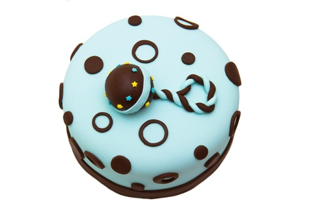Baby shower fondant cake with a rattle on top Stock Photo