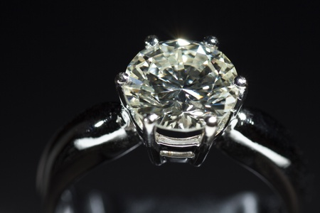 diamond ring: Two carat diamond ring with a dark background