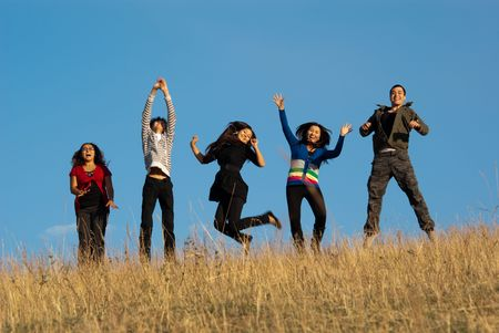 hay: Group of young asian beautiful people jumping for joy Stock Photo