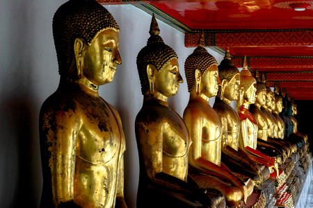 seated: Row of golden seated buddhas