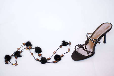 opentoe: Womans accessory - black beads and black open-toe sandal with spike heel Stock Photo