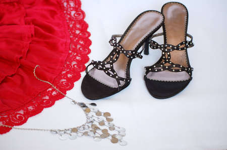 stilleto: Elegant lady shoe with attractive red skirt and bijouterie