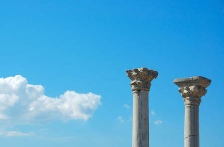 solidity: Two ancient columns on sky background in Hersones