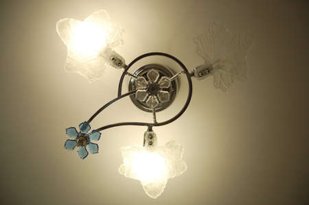 lustre: Lustre with two switched on and one switched off saving light bulbs