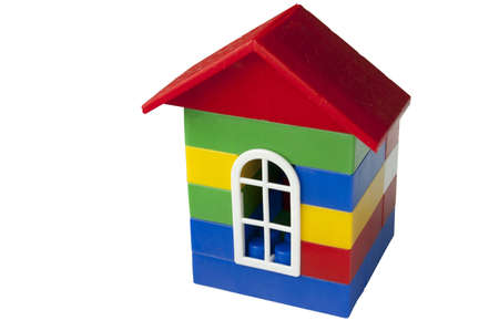plastic bricks: House with red roof made from colorful plastic bricks