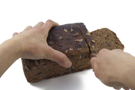 Cutting Brown (rye) bread on white backround photo