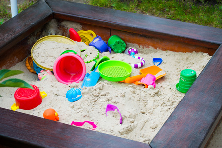 bolter: Nursery sandbox on the playground with sand bucket, rake, shovel, sieve and other equipment for sand work Stock Photo
