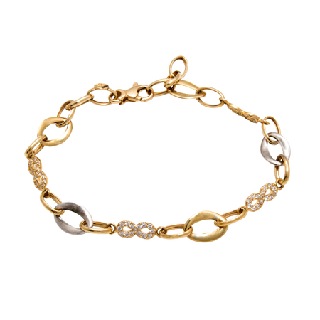 Graceful golden diamond chain bracelet from white and yellow gold isolated on white background