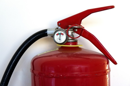 fire safety: Fire extinguisher on a wall closeup  Stock Photo