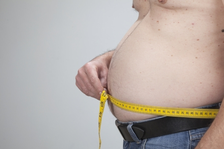 big belly of a fat man and measuring tape isolated on white Stock Photo - 18517905