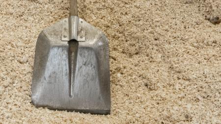 Shovel over pile of shavings Stock Photo - 21504696