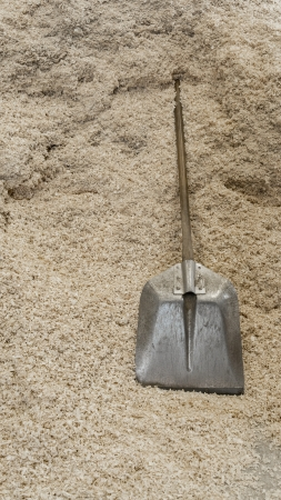 Shovel over pile of shavings Stock Photo - 21504703