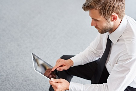 High angle view of a businessman using a digital tablet