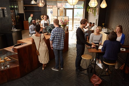 high angle view: High angle view of a modern style coffee shop with  customers