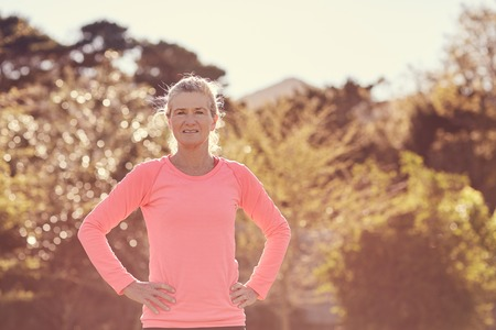 senior woman: Portrait of a confident senior woman standing outdoors on a sunlit morning ready for some health and fitness exercise Stock Photo