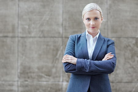 arms folded: A young businesswoman with her arms folded