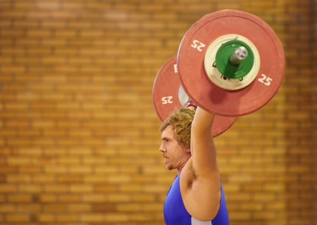 lifter: A weight lifter lifting weights during a competition Stock Photo